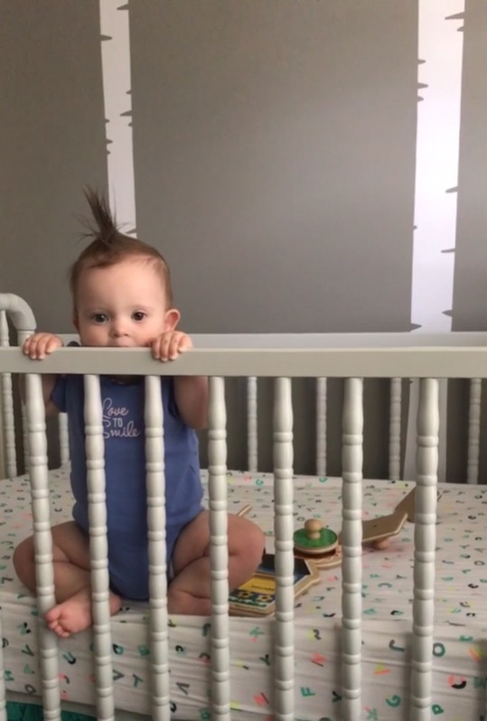 Kara teething on her crib