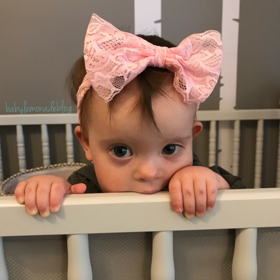 Beautiful baby girl getting ready for her second trip to the Down syndrome clinic. Read more for a free print out that will help guide you through your next visit to the Down syndrome clinic in your area.